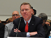 """Washington, DC - December 5, 2008 -- Alan Mulally, President and Chief Executive Officer, Ford Motor Company, testifies before the United States House Financial Services Committee hearing """"On review of industry plans to stabilize the financial condition of the American automobile industry""""  in Washington, D.C. on Friday, December 5, 2008.  He was there with other auto industry leaders to request $35 billion in loans from Congress to insure their respective company's survival..Credit: Ron Sachs / CNP"""