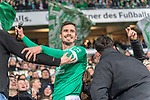 09.03.2019, Weser Stadion, Bremen, GER, 1.FBL, Werder Bremen vs FC Schalke 04, <br /> <br /> DFL REGULATIONS PROHIBIT ANY USE OF PHOTOGRAPHS AS IMAGE SEQUENCES AND/OR QUASI-VIDEO.<br /> <br />  im Bild<br /> <br /> gefeiert nach dem Spiel  Fin Bartels (Werder Bremen #22) von den Fans in der Osatkurve<br /> <br /> Foto &copy; nordphoto / Kokenge