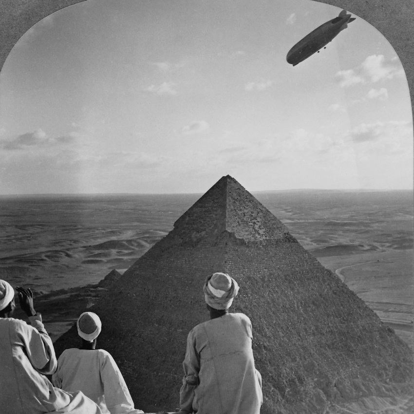 "Original Stereoscope caption ""The Graf Zeppelin's Rendezvous with the Eternal Desert and the More than 4,000 Year-old Pyramids of Gizeh, Egypt. Photo taken in 1931."
