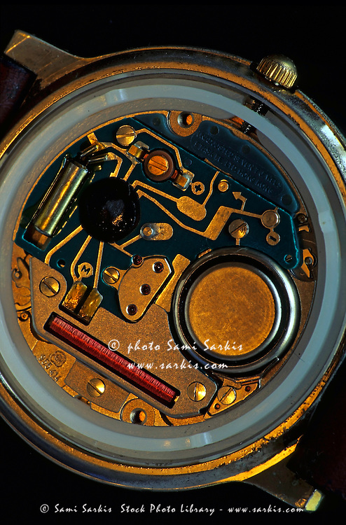 Integrated circuit and battery inside a wristwatch