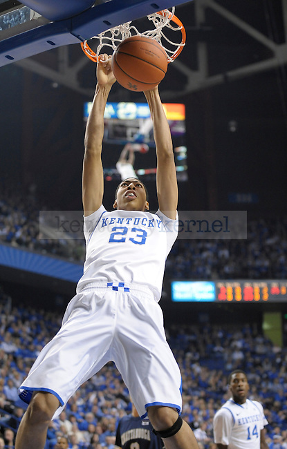Anthony Davis (23) dunks the ball during the first half of the University of Kentucky Basketball game against Chattanooga at Rupp Arena in Lexington, Ky., on 12/17/11.  Photo by Mike Weaver | Staff