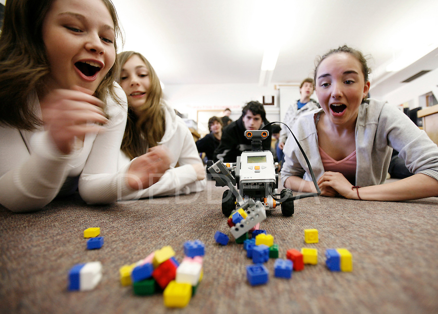 Grade nine and ten students Sam Rush, 15, Alex Gurney, 14, Perry Campbell, 15, and Courtney Roskelley, 14, cheer as their Lego replica Mars Explorer robot they built successfully picks up Lego blocks using a remote computer program, in their Science class Tuesday at Oak Bay Secondary School in Victoria, British Columbia. Photo assignment for the Globe and Mail national newspaper in Canada.