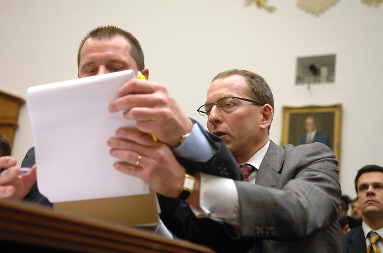 Roger Clemens, left, former MLB pitcher, gets a word from his attorney Lanny Brewer, during a House Oversight and Government Reform Committee hearing on steroid use in baseball.  Brian McNamee, former personal trainer to Clemens, and Charlie Scheeler, member former Sen. George Mitchell's report on performance enhancing drugs in baseball, also testified.