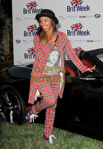 "Downtown Julie Brown.7th Annual BritWeek Festival ""A Salute To Old Hollywood"" Launch Party held at the British Consul General's Residence, Los Angeles, California, USA..April 23rd, 2013.full length suit boots red blue white union jacket tartan plaid trousers hat black suit jacket grey gray top print queen elizabeth II 2nd queen standing on one foot leg up arms posing.CAP/ADM/KB.©Kevan Brooks/AdMedia/Capital Pictures"