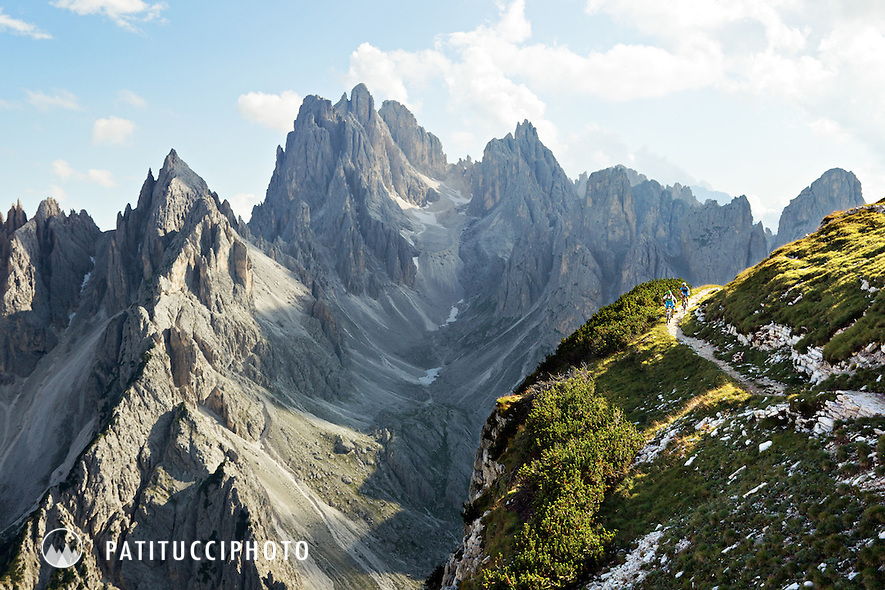 Two mountain bikers in the dramatic landscape of the Italian Dolomites