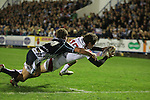 Ulster full back Jared Payne dives over to score a try despite the efforts of Harry Robinson to stop him..RaboDirect Pro12.Cardiff Blues v Ulster Rugby.Cardiff Arms Park.28.09.12.©Steve Pope