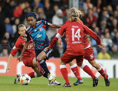 26.05.2011 Womens Champions League Final from Craven Cottage in London. FFC Turbine Potsdam v Olympique Lyonnais. Lyonnaise won 2-0. Thomis of Lyonnaise takes on three Potdam defenders