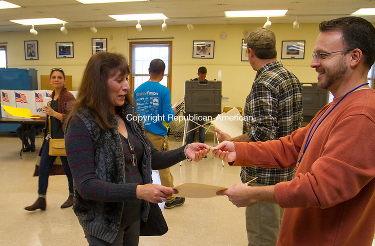 """CHESHIRE, CT - 08 NOVEMBER 2016 - 110816JW01.jpg -- Tabulator monitor Brian Jones hands his last """"I Voted"""" sticker to Carol Indino of Cheshire at the Artsplace voting district. Jones said the brisk pace of voters left him with no stickers left at 11:30 a.m.    Jonathan Wilcox Republican-American"""