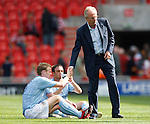 Sven Goran Eriksson thanks his players after their win at Doncaster