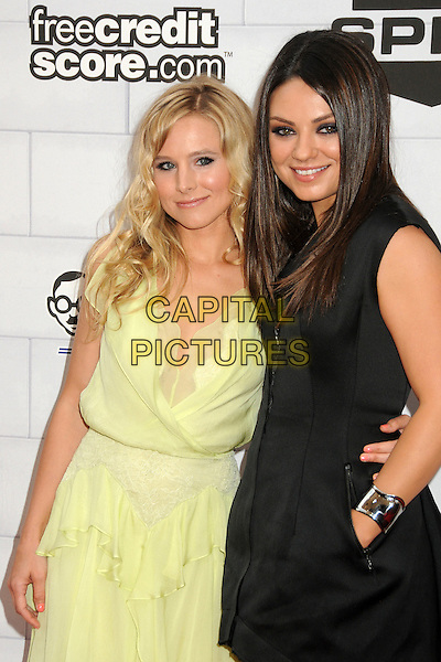 "Kristen Bell, Mila Kunis.Spike TV's 6th Annual ""Guys Choice"" Awards held at Sony Pictures Studios, Culver City, California, USA, .2nd June 2012..half length yellow ruffle sheer black zip up sleeveless hand in pocket silver bracelet cuff arm around dress .CAP/ADM/BP.©Byron Purvis/AdMedia/Capital Pictures."