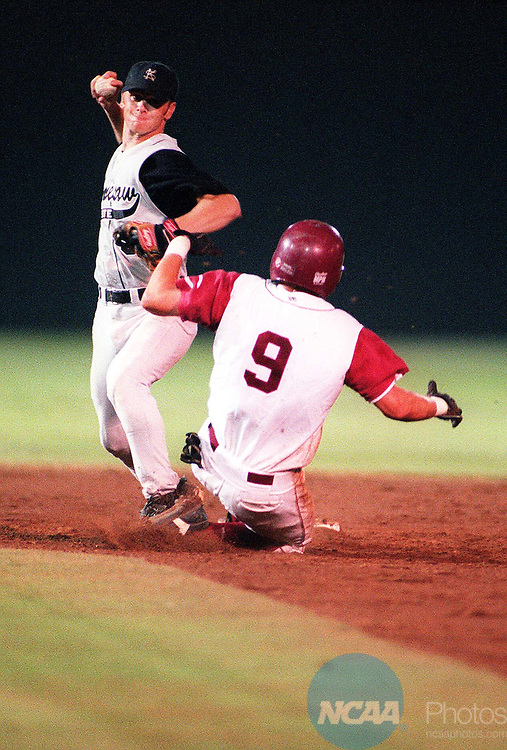 29 MAY 1999: Kennesaw short stop Keith Hunter looks to make a double play after tagging out Chico State's Shanin Veronie (9) during the Men's Division II Baseball Championship held at Paterson Field in Montgomery, AL. Chico State defeated Kennesaw 11-5 for the championship title. Paul Adams/NCAA Photos.