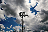 USA, Oregon, Grass Valley, a windmill stands beneath a dramatic cloudy sky