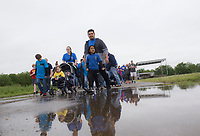 NWA Democrat-Gazette/CHARLIE KAIJO Attendees participate in the Autism Involves Me annual walk, Saturday, May 4, 2019 at the Benton County Fairgrounds in Bentonville. <br /><br />Autism Involves Me, a Bentonville non-profit, held its annual walk to highlight the lack of services for kids with autism.