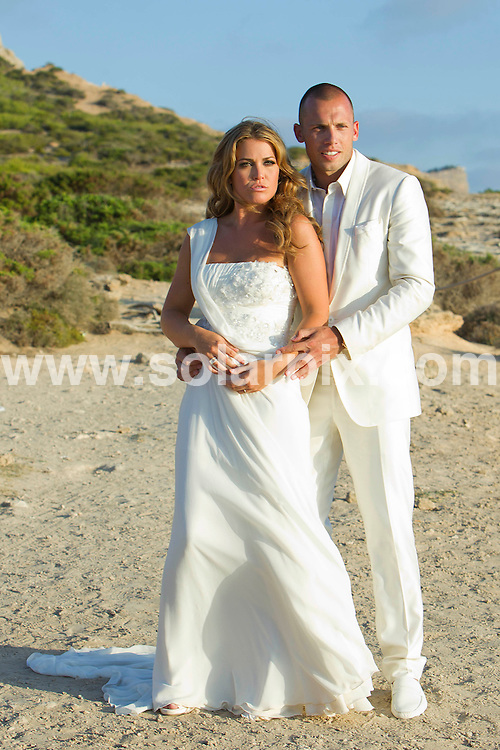 **ALL-ROUND PICTURES FROM SOLARPIX.COM**.**SYNDICATION RIGHTS FOR UK ONLY**.Dutch footballer John Heitinga's wedding in Ibiza today. The Holland and Everton defender married his fiancé Charlotte Zenden, the sister of Boudewijn Zenden who once played for Everton's local rivals Liverpool. Ibiza, Spain. 15 July 2010..This pic: John Heitinga & Charlotte Zenden..JOB REF: 11684 SKX      DATE: 15_07_2010.**MUST CREDIT SOLARPIX.COM OR DOUBLE FEE WILL BE CHARGED**.**MUST NOTIFY SOLARPIX OF ONLINE USAGE**.**CALL US ON: +34 952 811 768 or LOW RATE FROM UK 0844 617 7637**