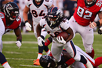 Ohio, Canton - August 1, 2019: Denver Broncos running back Devontae Jackson #48 is tackled by Atlanta Falcons linebacker Foye Oluokun #54 during a pre-season game against the Atlanta Falcons at the Tom Benson stadium in Canton, Ohio August 1, 2019. This game marks start of the 100th season of the NFL. (Photo by Don Baxter/Media Images International)