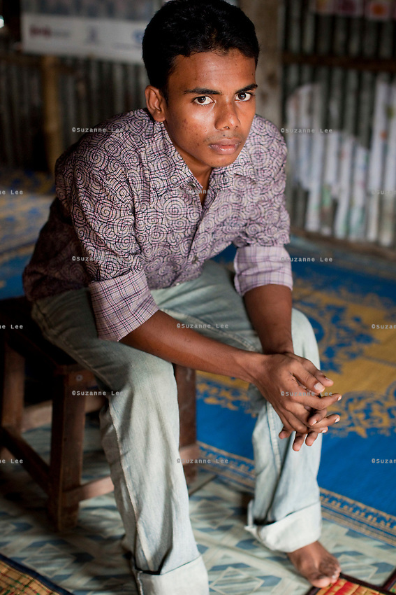 """Jewel Mahammud Kawsan (17) sits for a portrait in the meeting hut of a Children's Group in Bhashantek Basti (Slum) in Zon H, Dhaka, Bangladesh on 23rd September 2011. When asked if an abused wife could return to her family, Jewel says, """"Society doesn't take it well. It is not accepted if she leaves the husband's house. Even (her own parents) will tell her to be accommodative even if her husband beats her, because after marriage, that is now her real address."""" Jewel also tells a true story of a girl who used to be a member of the children's group. When she turned 14/15, her parents wanted to marry her off. The children's group went to village elders to counsel the family and the marriage was stopped. The children felt proud but sadly, after 2 months, she was quietly married off. Now, at 18, she is a mother of a girl child and is not happy in the marriage. Her husband is also a young boy but is violent in nature and beats her. She is tied to motherhood and house chores and not allowed to join the other children. The families are also fighting because of dowry related issues."""" The Bhashantek Basti Childrens Group is run by children for children with the facilitation of PLAN Bangladesh and other partner NGOs. Slum children from ages 8 to 17 run the group within their own communities to protect vulnerable children from child related issues such as child marriage. Photo by Suzanne Lee for The Guardian"""