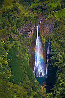 An aerial view of rainbow-clothed Manawaiopuna Falls, more famously known as Jurassic Falls, Hanapepe Valley, Kaua'i.