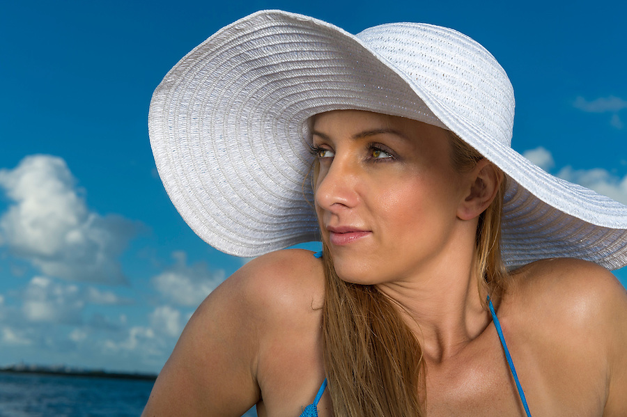Portrait of beautiful causasian woman with hat in the caribbean.
