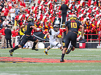 College Park, MD - September 9, 2017: Towson Tigers running back Adrian Platt (27) avoids a Maryland Terrapins defender during game between Towson and Maryland at  Capital One Field at Maryland Stadium in College Park, MD.  (Photo by Elliott Brown/Media Images International)