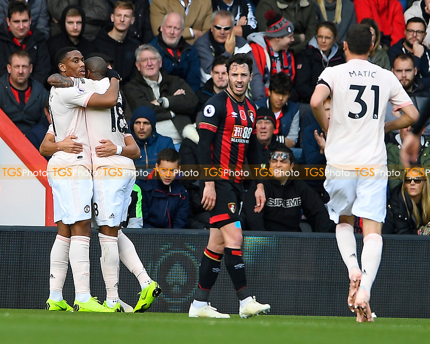 Anthony Martial of Manchester United and Ashley Young of Manchester United celebrate as Adam Smith of AFC Bournemouth looks dejected during AFC Bournemouth vs Manchester United, Premier League Football at the Vitality Stadium on 3rd November 2018