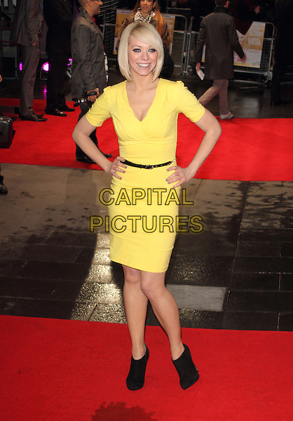 "Liz McClarnon.The ""Run For Your Wife"" world film premiere, Odeon Leicester Square cinema, Leicester Square, London, England..February 5th, 2013.full length yellow dress hands on hips black belt booties shooboots shoes boots.CAP/ROS.©Steve Ross/Capital Pictures"