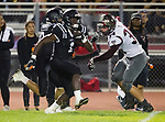 Lawndale, CA 09/29/17 - Jordan Wilmore (Lawndale #1) and Nick O'keefe (Torrance #34) in action during the Torrance vs Lawndale CIF Varsity football game at Lawndale High School.   Lawndale defeated Torrance 42-0.