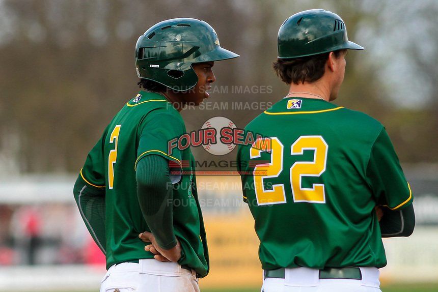 Beloit Snappers shortstop Eric Marinez (2) and manager Scott Steinmann (22) look on from third base during a Midwest League game against the Peoria Chiefs on April 15, 2017 at Pohlman Field in Beloit, Wisconsin.  Beloit defeated Peoria 12-0. (Brad Krause/Four Seam Images)