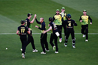 Ashton Agar of Australia celebrates with teammates for the wicket of Colin de Grandhomme of New Zealand. New Zealand Black Caps v Australia, Final of Trans-Tasman Twenty20 Tri-Series cricket. Eden Park, Auckland, New Zealand. Wednesday 21 February 2018. © Copyright Photo: Anthony Au-Yeung / www.photosport.nz