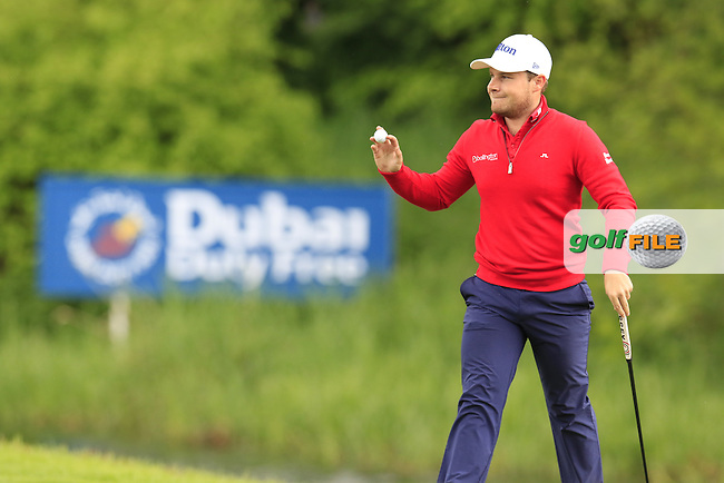 Tyrrell Hatton (ENG) sinks his putt on the 17th green during Sunday's Final Round of the 2016 Dubai Duty Free Irish Open hosted by Rory Foundation held at the K Club, Straffan, Co.Kildare, Ireland. 22nd May 2016.<br /> Picture: Eoin Clarke | Golffile<br /> <br /> <br /> All photos usage must carry mandatory copyright credit (&copy; Golffile | Eoin Clarke)