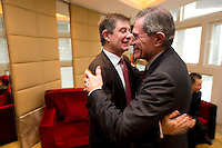 French Financial Markets Authority Chairman Jean-Pierre Jouyet (left), hugs GDF Suez CEO and Paris Europlace Chairman Gerard Mestrallet (right), before Shanghai / Paris Europlace Financial Forum, in Shanghai, China, on December 1, 2010. Photo by Lucas Schifres/Pictobank