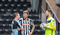 Garry Thompson of Wycombe Wanderers chats to Jonathan Stead of Notts County & Goalkeeper Scott Loach of Notts County during a break in play during the Sky Bet League 2 match between Notts County and Wycombe Wanderers at Meadow Lane, Nottingham, England on 28 March 2016. Photo by Andy Rowland.