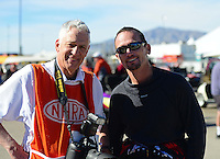 Oct. 26, 2012; Las Vegas, NV, USA: NHRA funny car driver Jack Beckman (right) with photographer Jon Asher during qualifying for the Big O Tires Nationals at The Strip in Las Vegas. Mandatory Credit: Mark J. Rebilas-