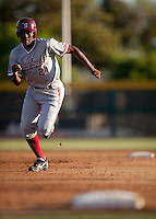STOCKTON, CA - May 9, 2011: Brian Ragira of Stanford baseball races to third base during Stanford's game against Pacific at Klein Family Field in Stockton. Stanford won 11-5.