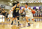 SIOUX FALLS, SD - JANUARY 2:  Jaicee Ulmer #14 from the University of Sioux Falls pushes the ball past Sophie Kenney #5 from Augustana in the first half of their game Friday night at the Stewart Center. (Photo by Dave Eggen/Inertia)