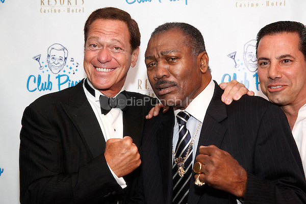 Joe Piscopo pictured with Joe Frazier at his new club, Club Piscopo on opening night at Resorts Casino in Atlantic City on July 1, 2011  © Star Shooter / MediaPunchInc