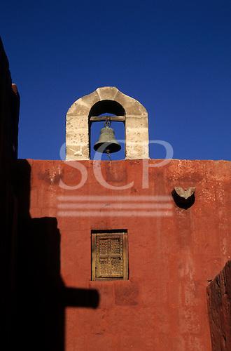 Arequipa, Peru. Bell on top of building; Santa Catalina Monastery.
