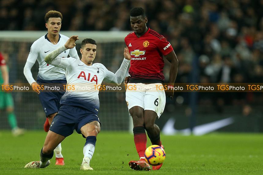 Paul Pogba of Manchester United and Erik Lamela of Tottenham Hotspur during Tottenham Hotspur vs Manchester United, Premier League Football at Wembley Stadium on 13th January 2019