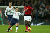 Paul Pogba of Manchester United and Erik Lamela of Tottenham Hotspur during Tottenham Hotspur vs Manchester United, Premier League Football at Wembley Stadium on 13th January 2019