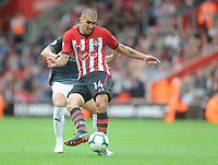 Southampton's Oriol Romeu under pressure from Burnley's Ashley Westwood<br /> <br /> Photographer Kevin Barnes/CameraSport<br /> <br /> The Premier League - Southampton v Burnley - Sunday August 12th 2018 - St Mary's Stadium - Southampton<br /> <br /> World Copyright &copy; 2018 CameraSport. All rights reserved. 43 Linden Ave. Countesthorpe. Leicester. England. LE8 5PG - Tel: +44 (0) 116 277 4147 - admin@camerasport.com - www.camerasport.com