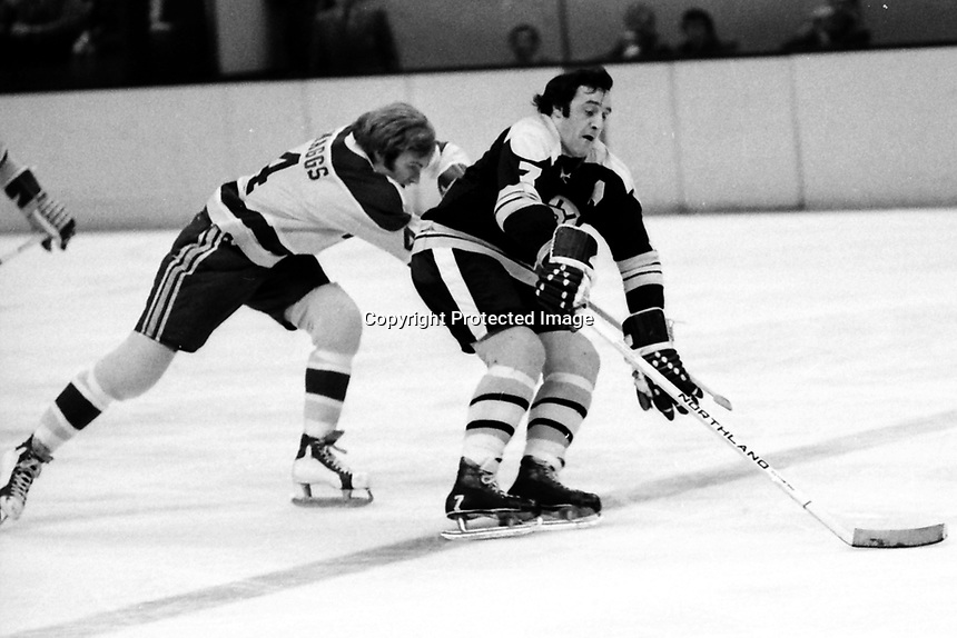 Seals Darryl Maggs with Boston Bruins Phil Esposito.<br />