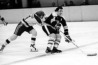 Seals Darryl Maggs with Boston Bruins Phil Esposito.<br />(1973 photo/Ron Riesterer)