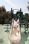September 14, 2011. Raleigh, NC. . Mia Cofield goes down the slide at recess.. Project Enlightenment, a public pre-kindergarten program for at risk children, has been threatened with closure due to state wide budget cuts..