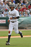 Charleston Riverdogs center fielder Mason Williams #9 coming in to the dugout after being caught stealing at third base during a game against the Savannah Sand Gnats at Joseph P. Riley Jr. Park on May 16, 2012 in Charleston, South Carolina. Charleston defeated Savannah by the score of 14-5. (Robert Gurganus/Four Seam Images)