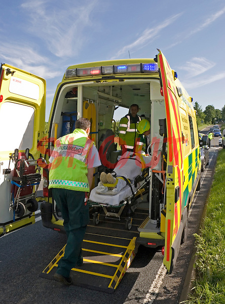 Firefighters and Paramedic crews attend RTC and work together to release the trapped driver. Warwickshire UK. This image may only be used to portray the subject in a positive manner..©shoutpictures.com..john@shoutpictures.com