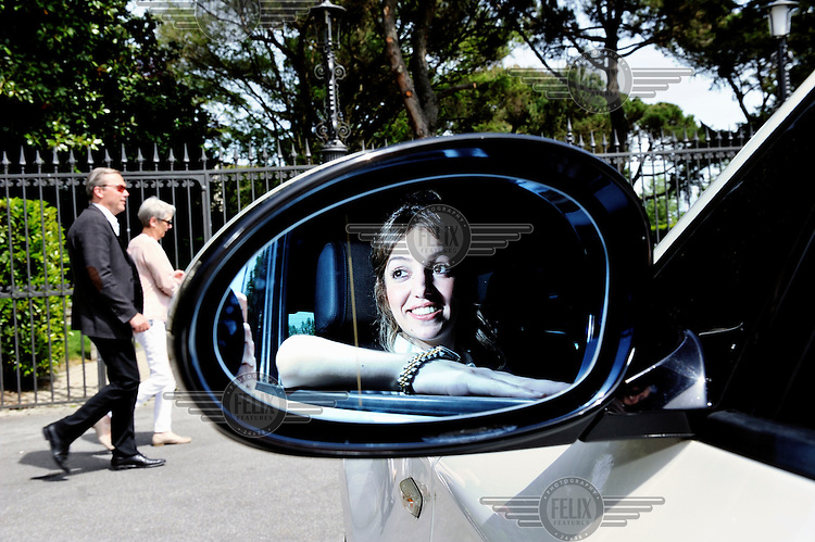 Independent chauffeur Kamelia Benmira with one of her cars, photographed in Ouchy, Lausanne by the Beau-Rivage Palace.