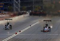 Apr 9, 2006; Las Vegas, NV, USA; NHRA Top Fuel driver Melanie Troxel, right, driver of the Skull Gear/Torco Race Fuels dragster defeats Doug Kalitta to advance to a record setting sixth consecutive final round during eliminations at the SummitRacing.com Nationals at Las Vegas Motor Speedway in Las Vegas, NV. Mandatory Credit: Mark J. Rebilas