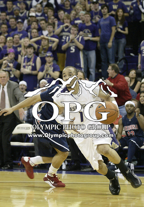 28 February 2009:  Washington Husky guard #1 Venoy Overton drives to the basket against Arizona at the Bank of America Arena at Hec Edmundson Pavilion in Seattle, WA.  Washington won 83-78 over Arizona.