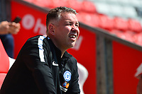 Peterborough United manager Darren Ferguson looks on<br /> <br /> Photographer Richard Martin-Roberts/CameraSport<br /> <br /> The EFL Sky Bet League One - Fleetwood Town v Peterborough United - Friday 19th April 2019 - Highbury Stadium - Fleetwood<br /> <br /> World Copyright © 2019 CameraSport. All rights reserved. 43 Linden Ave. Countesthorpe. Leicester. England. LE8 5PG - Tel: +44 (0) 116 277 4147 - admin@camerasport.com - www.camerasport.com