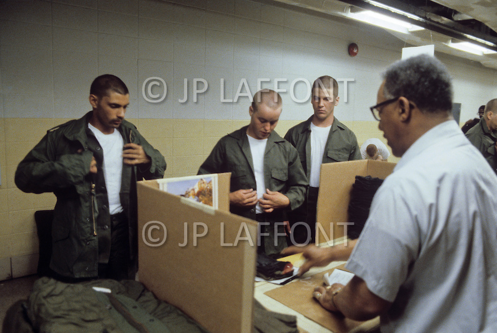 Fort Dix, NJ, USA, June 1980. A uniform is assigned to each recruit.