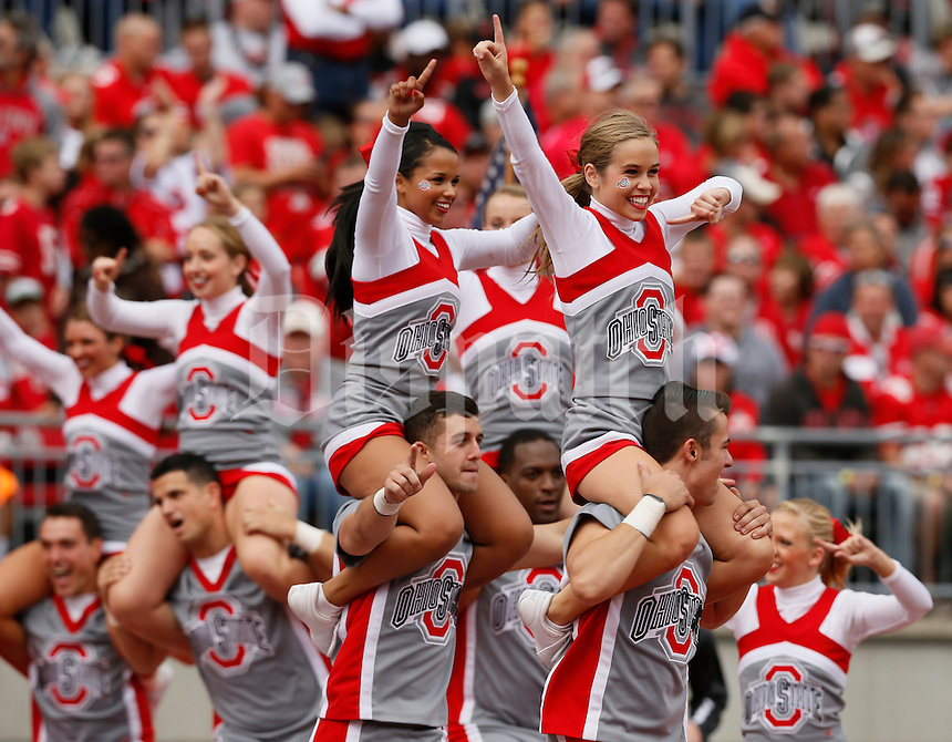 The Ohio State University cheerleaders celebrate a touchdown during Saturday's NCAA Division I football game between the Ohio State Buckeyes and the Kent State Golden Flashes at Ohio Stadium in Columbus on September 13, 2014. Ohio State won the game 66-0. (Dispatch Photo by Barbara J. Perenic)